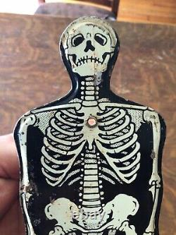 Vintage Halloween US Metal Skeleton Noisemaker Rare